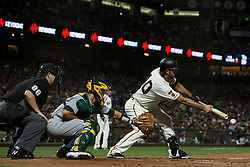 SAN FRANCISCO, CA - AUGUST 13: Madison Bumgarner #40 of the San Francisco Giants hits a sacrifice bunt against the Oakland Athletics during the seventh inning at Oracle Park on August 13, 2019 in San Francisco, California. The San Francisco Giants defeated the Oakland Athletics 3-2. (Photo by Jason O. Watson/Getty Images) *** Local Caption *** Madison Bumgarner