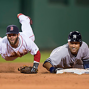 BOSTON, MA - APRIL 22:  Dustin Pedroia #15 of the Boston Red Sox falls to the ground after completing a double play over Derek Jeter #2 of  the New  York Yankees in the second inning at Fenway Park on April 22, 2014 in Boston, Massachusetts.  (Photo by Michael Ivins/Boston Red Sox/Getty Images) *** Local Caption ***Dustin Pedroia; Derek Jeter