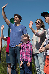 """Prime Minister Justin Trudeau waves with his wife, Sophie Gregoire Trudeau, and his daughter Ella Grace Trudeau at the """"Paddle The Rouge"""" event at Rouge Beach Park in Toronto, Saturday, June 18, 2016. Photo by Mark Blinch/CP/ABACAPRESS.COM    551986_005 Toronto Canada"""