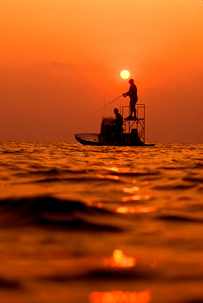 Stock photo of two men fishing from a small fishing boat in Laguna Madre