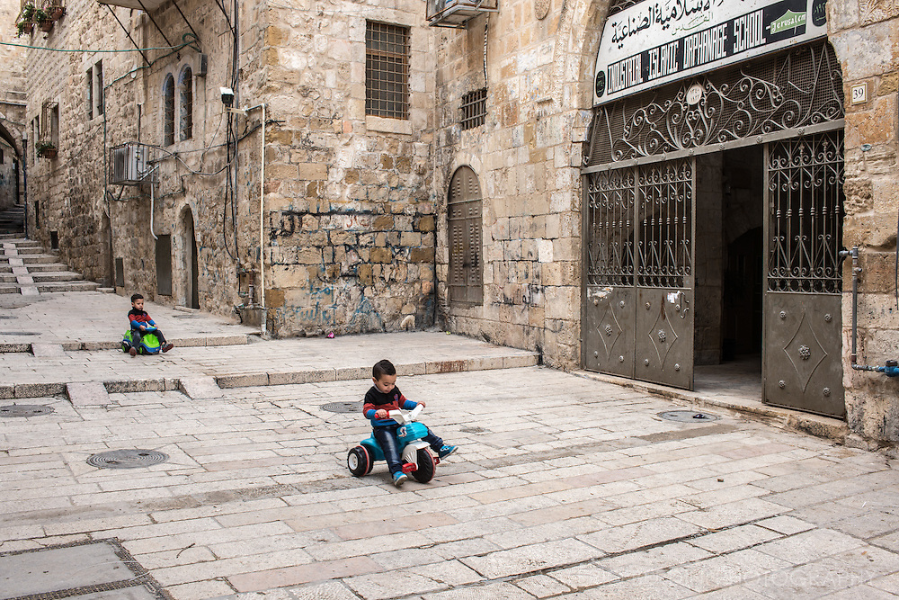 Children play in front of an orphanage school in the Muslim quarter of the Old City in Jerusalem.