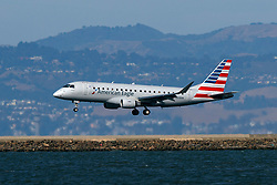 Embraer ERJ-175LR (N208AN) operated by Compass Airlines for American Eagle landing at San Francisco International Airport (KSFO), San Francisco, California, United States of America