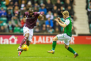Clevid Dikamona (#28) of Heart of Midlothian takes on Daryl Horgan (#7) of Hibernian FC during the Ladbrokes Scottish Premiership match between Hibernian FC and Heart of Midlothian FC at Easter Road Stadium, Edinburgh, Scotland on 29 December 2018.