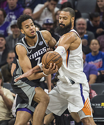 December 12, 2017 - Sacramento, CA, USA - The Sacramento Kings' Skal Labissiere (7) is defended by the Phoenix Suns' Tyson Chandler on Tuesday, Dec. 12, 2017, at the Golden 1 Center in Sacramento, Calif. (Credit Image: © Hector Amezcua/TNS via ZUMA Wire)