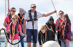 Simon Le Bon (centre) arrives back at Gunwharf Quays on board a 72 foot Challenger yacht with members of the Tall Ships Youth Trust team, after racing in the Solent.