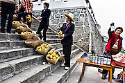 CHINA, SANDOUPING:  Vendors agressively selling fresh fruit and wine meet the cruise ships that stop at Sandouping and the Three Gorges Dam during a Yangtze River Cruise. Photo Illustration.