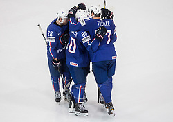 Damien Raux of France, Teddy da Costa of France and Sacha Treille of France celebrate after winning during the 2017 IIHF Men's World Championship group B Ice hockey match between National Teams of France and Belarus, on May 12, 2017 in AccorHotels Arena in Paris, France. Photo by Vid Ponikvar / Sportida
