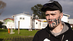 "EXCLUSIVE: Mark Cropp wants to get off the dole, get a job and put food on the table for his family. But there's one small problem - a giant tattoo saying ""DEVAST8"" that covers half of his face is proving off-putting for prospective employers. 13 Jul 2017 Pictured: Mark Cropp. Photo credit: NZ Herald / MEGA TheMegaAgency.com +1 888 505 6342"