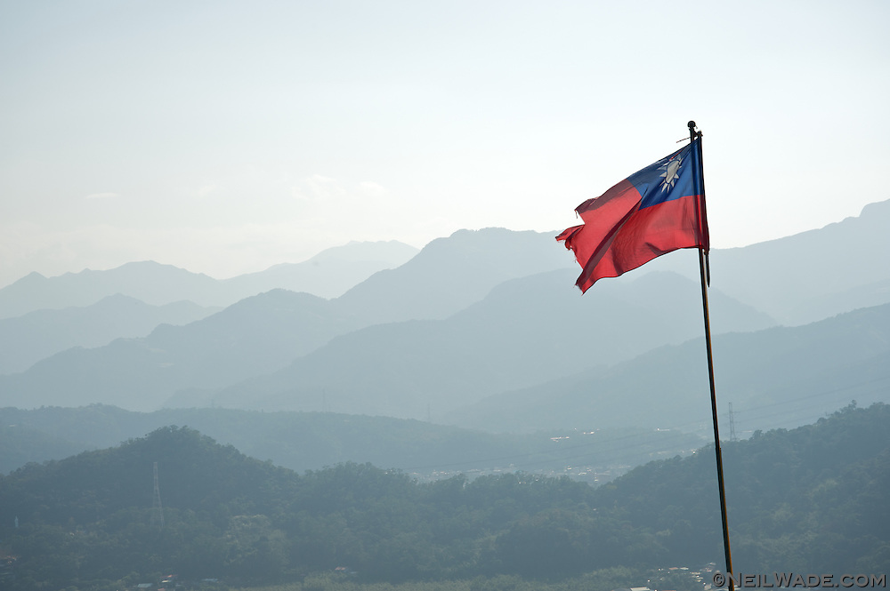 A torn Taiwan flag waves in the breeze in Taipei, Taiwan.