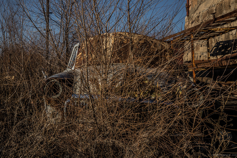 Abandoned blue soviet car in the middle of the vegetation. Gyumri, Armenia
