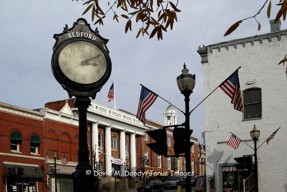 Clock in downtown Bedford, Virgina, decorated with American Flags. Piedmont region.