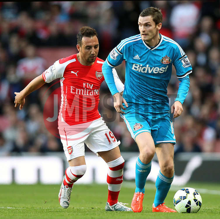 Sunderland's Adam Johnson under pressure from Arsenal's Santi Cazorla - Photo mandatory by-line: Robbie Stephenson/JMP - Mobile: 07966 386802 - 20/05/2015 - SPORT - Football - London - Emirates Stadium - Arsenal v Sunderland - Barclays Premier League