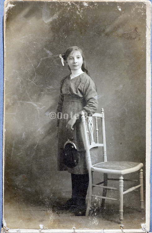 old damaged image of young girl in studio setting
