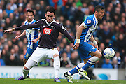 Brighton striker Tomer Hemed gets the better of Derby County midfielder George Thorne during the Sky Bet Championship match between Brighton and Hove Albion and Derby County at the American Express Community Stadium, Brighton and Hove, England on 2 May 2016. Photo by Bennett Dean.