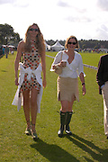 Anna Law and Martina Bonin. Cartier International Day at Guards Polo Club, Windsor Great Park. July 24, 2005. ONE TIME USE ONLY - DO NOT ARCHIVE  © Copyright Photograph by Dafydd Jones 66 Stockwell Park Rd. London SW9 0DA Tel 020 7733 0108 www.dafjones.com
