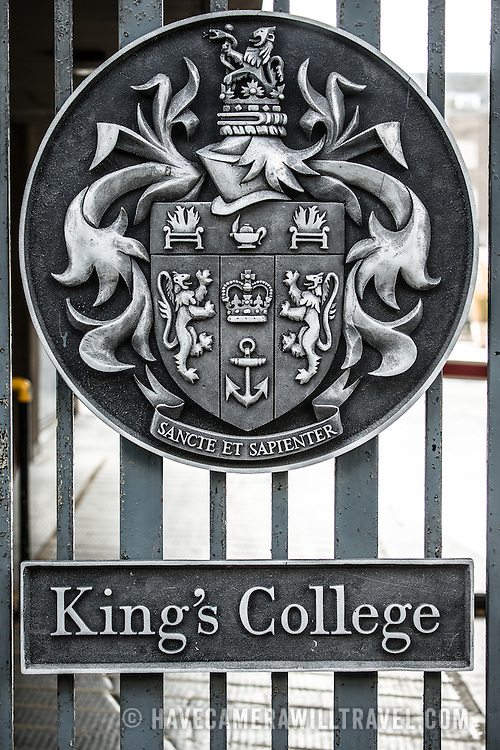 The seal of King's College, London, on the entrance gates facing the Strand in central London.