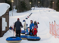 The lanes at Gunstock's tubing hill were perfect as the Boys and Girls Club came out for a Tubing Party on Sunday evening.  (Karen Bobotas/for the Laconia Daily Sun)