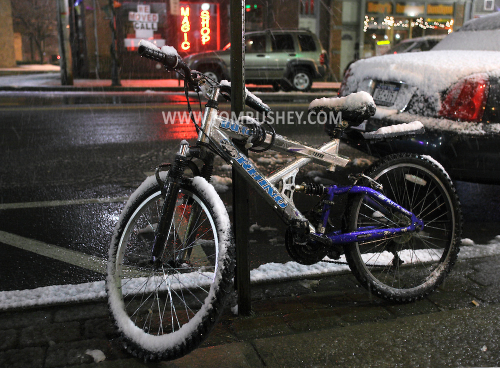 Middletown, NY - A bicycle is locked to a sign during a snowstorm on the night of Dec. 5, 2009.