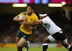 Fiji Hooker Talemaitoga Taupati tackles Australia Full Back Israel Folau  - Mandatory byline: Joe Meredith/JMP - 07966386802 - 23/09/2015 - Rugby Union, World Cup - Millenium Stadium -Cardiff,Wales - Australia v Fiji - Rugby World Cup 2015 - Pool A