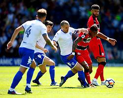 Rajiv van La Parra of Huddersfield Town is tackled by Stephen Dawson of Bury - Mandatory by-line: Matt McNulty/JMP - 16/07/2017 - FOOTBALL - Gigg Lane - Bury, England - Bury v Huddersfield Town - Pre-season friendly