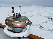 The M/S Explorer cruises through sea ice in Antarctica in February 2005. A nautical navigation instrument helps guide the ship. The M/S Explorer sank after hitting an iceberg in 2007, and now lies sunk 600 meters deep in the Southern Ocean. Two and a half years after our successful trip, the Explorer, owned by Canadian travel company GAP Adventures, took on water after hitting ice at 12:24 AM EST on Friday November 23, 2007. 154 passengers and crew calmly climbed into lifeboats and drifted some six hours in calm waters. A Norwegian passenger boat rescued and took them to Chile's Antarctic Eduardo Frei base, where they were fed, clothed, checked by a doctor, and later flown to Punta Arenas, Chile. The ship sank hours after the passengers and crew were safely evacuated.