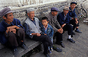 Bai tribespeople dress in traditional blue, Lijiang, Yunnan, China