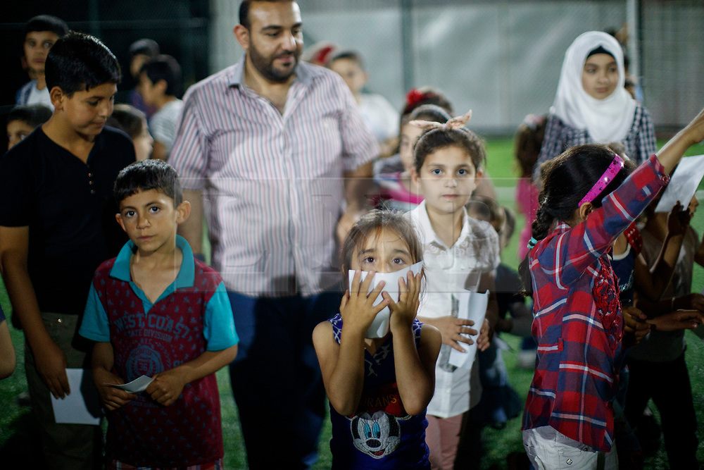 © Licensed to London News Pictures. 28/05/2017. Kırıkhan, TURKEY. Syrian orphans play at an orphanage on the Turkish-Syrian border in Kırıkhan, near Antakya, Turkey on the first day of Ramadan during Former Minister of State for Faith and Communities, Baroness Warsi's visit. Photo credit: Tolga Akmen/LNP