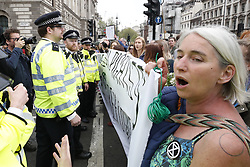© Licensed to London News Pictures. 24/04/2019. London, UK. Climate change protestors are surrounded by police as they block Parliament Square. Extinction Rebellion demonstrations are continuing I a small scale in parts of the capital. Photo credit: Peter Macdiarmid/LNP