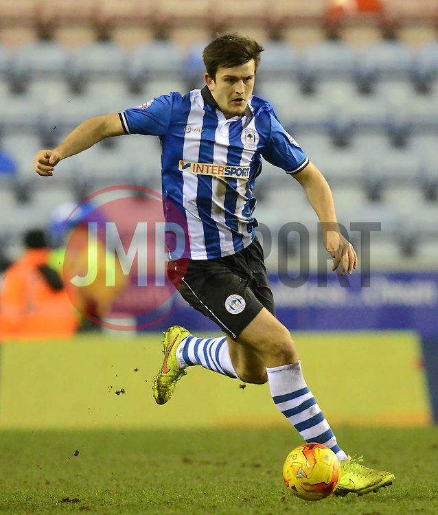 Wigan Athletic's Harry Maguire in action - Photo mandatory by-line: Richard Martin-Roberts/JMP - Mobile: 07966 386802 - 24/02/2015 - SPORT - Football - Wigan - DW Stadium - Wigan Athletic v Cardiff City - Sky Bet Championship