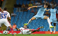 Football - 2016 / 2017 Champions League - Qualifying Play-Off, Second Leg: Manchester City [5] vs. Steaua Bucharest [0]<br /> <br /> John Stones of Manchester City and Alexandru Tudorie of Steaua Bucharest during the match, at the Ethihad Stadium.<br /> <br /> COLORSPORT/LYNNE CAMERON