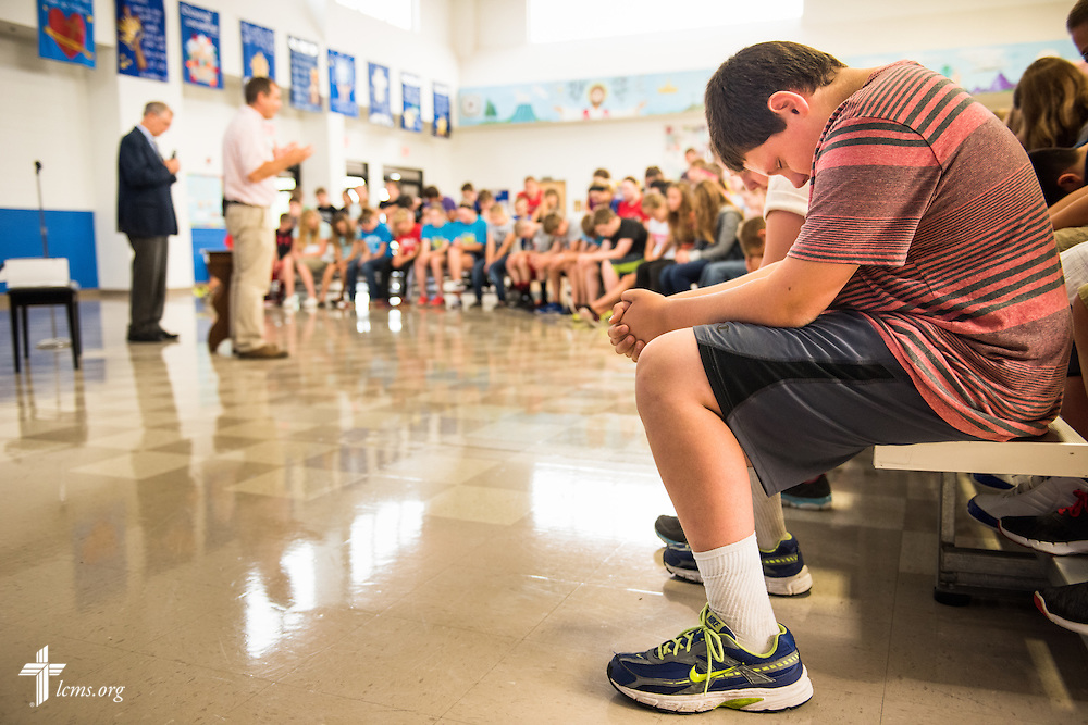 Students pray before the Rev. Dr. James Lamb, retiring executive director of Lutherans for Life, leads an Owen's Mission presentation at Trinity Lutheran School on Monday, August 31, 2015, in Bloomington, Ill. LCMS Communications/Erik M. Lunsford