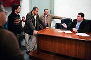 Pedro Romero, the mayor of Espera, talks with local businessmen during a meeting in Espera, Spain.