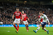 Tottenham Hotspur midfielder Giovani Lo Celso (18) shoots towards the goal during the FA Cup third round replay match between Tottenham Hotspur and Middlesbrough at Tottenham Hotspur Stadium, London, United Kingdom on 14 January 2020.