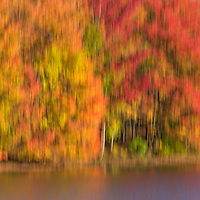 Early morning sun lights up the shoreline of the Clear Fork reservoir  during peak autumn color. Captured with long exposure tilt for impressionistic effect.