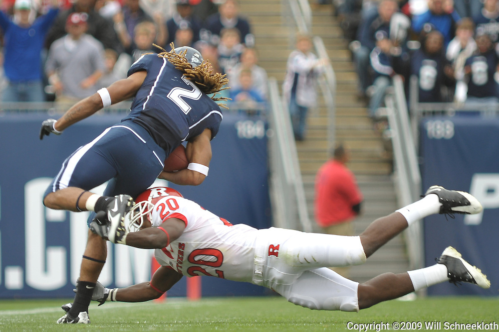 Oct 31, 2009; East Hartford, CT, USA; Rutgers cornerback Khaseem Greene (20) makes a touchdown saving tackle on Connecticut running back Andre Dixon (2) during first half Big East NCAA football action between Rutgers and Connecticut at Rentschler Field.