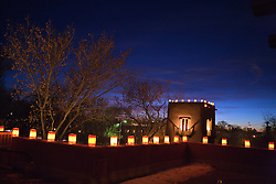Farolitas line the roof top of the Inn on the Alameda at sunset, Santa Fe, New Mexico, United States of America