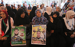 September 11, 2017 - Gaza City, Gaza Strip, Palestinian Territory - Palestinians take part in a protest to show solidarity with Palestinian prisoners held in Israeli jails, in front of Red cross office in Gaza city on September 11, 2017  (Credit Image: © Mohammed Asad/APA Images via ZUMA Wire)