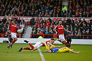 Leeds United midfielder Jack Harrison (22), Nottingham Forest's Nottingham Forest defender Jack Robinson (18)  during the EFL Sky Bet Championship match between Nottingham Forest and Leeds United at the City Ground, Nottingham, England on 1 January 2019.