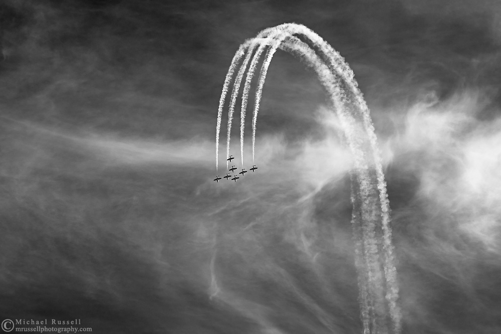 Canadian Forces Snowbirds completing a loop in the Arrow formation with smoke.  The Snowbirds are also known as the 431 Air Demonstration Squadron and fly the Canadair CT-114 Tutor jet. Photographed during the Canada 150 celebrations in White Rock, British Columbia, Canada.
