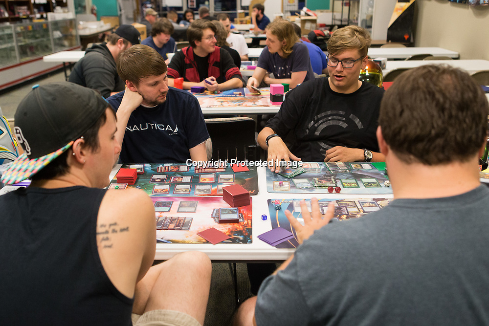 Martin Hayes, clockwise from top left, Landon Jones, Justin Crossly and Jacob Gafford play Magic: The Gathering Tuesday night at Tupelo Sportscards and Games. Most pods play with three or four people.