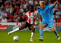 Photo: Alan Crowhurst.<br />Southampton v Coventry City. Coca Cola Championship. 09/08/2006. Bradley Wright-Phillips (L) of Saints turns his man.