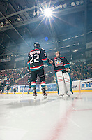 KELOWNA, CANADA - OCTOBER 18:  MacKenzie Johnston #22 and Jackson Whistle #1 of the Kelowna Rockets take part in a pre-game ritual on the ice as the Prince George Cougars visit the Kelowna Rockets on October 18, 2012 at Prospera Place in Kelowna, British Columbia, Canada (Photo by Marissa Baecker/Shoot the Breeze) *** Local Caption ***
