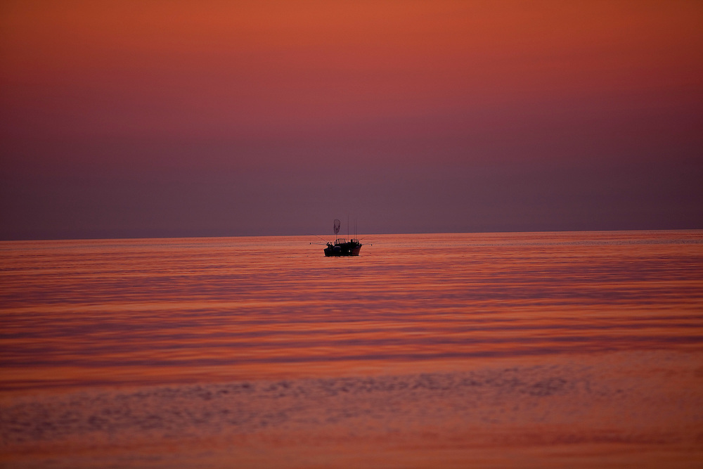 Sunrise during charter fishing on Lake Michigan near Sturgeon Bay, in Door County Wisconsin. (Mike Roemer Photography)