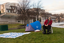 Campaigner, Ian Morrison from Kilwinning in Ayrshire has set up a tent in the grounds of the Scottish Parliament and has threatened to carry out a hunger strike until he is allowed to meet with SNP Health Minister, Shona Robison.<br /> <br /> Morrison's campaign relates to the use of opioids in treatment in the Scottish NHS where drug related general acute stays have increased from 41 people to 143 people per 100k between 1996 and 2016.<br /> <br /> Morrison has stated that he has spoken with his own MSP, Ruth Maguire who has told him that there is nothing she can do and Shona Robison's team have refused to allow him to discuss the issue with the Health Minister.