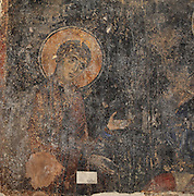 Fresco of a Saint with halo and arms outstretched, detail from a fresco of Christ, in the Church of Labova e Kryqit, or church of the Holy Cross, dedicated to St Mary, one of the oldest churches in Albania, mainly 13th century although with Byzantine foundations of 527-565 AD in the time of Emperor Justinian, Labova e Kryqit, Gjirokastra, Albania. The nave and aisle form a cruciform plan and the high central cupola is typically Byzantine. The interior walls are covered with 9 levels of frescoes. Picture by Manuel Cohen
