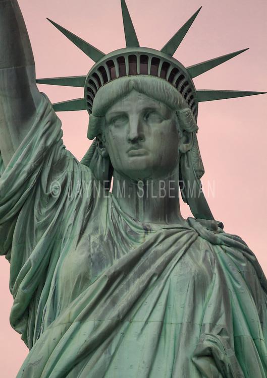 Lady Liberty at sunset in NY Harbor.
