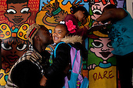 Marquis B-eazi Johnson, kisses his daughter, Zariyah  goodbye before her first day of Kindergarten at Prescott Elementary School in Lower Bottoms, West Oakland. Johnson attended Prescott from pre-k to 5th grade.