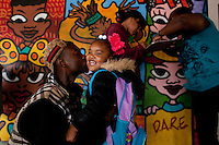 Marquis B-eazi Johnson, kisses his daughter, A'azyhra, good-bye before her first day of Kindergarten at Prescott Elementary School in Lower Bottoms, West Oakland. Johnson attended Prescott when he was a child from pre-k to 5th grade.