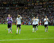 Dejected German players come to terms with losing their UEFA EURO 2012 semi final match between Germany and Italy at the National Stadium on June 28, 2012 in Warsaw, Poland.