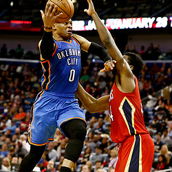 Dec 21, 2016; New Orleans, LA, USA;  Oklahoma City Thunder guard Russell Westbrook (0) shoots over New Orleans Pelicans forward Solomon Hill (44) during the second quarter of a game at the Smoothie King Center. Mandatory Credit: Derick E. Hingle-USA TODAY Sports